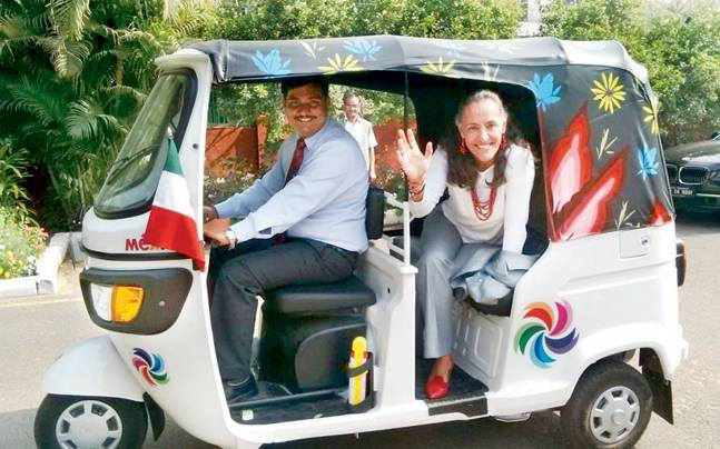 Malba Pria travels in a chaffeaur driven autorickshaw tuned with Mexican colors